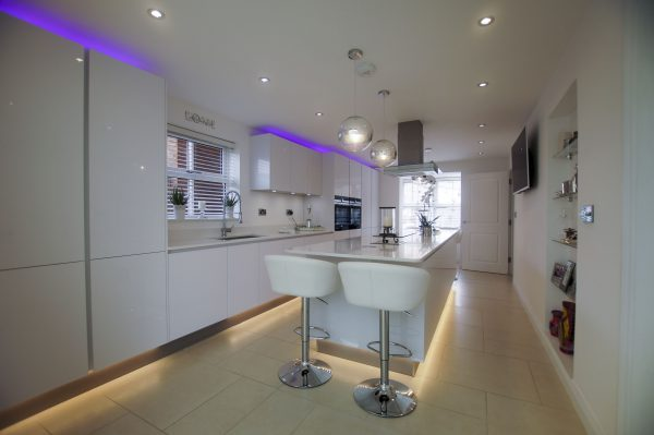 white high gloss kitchen with mood lighting installed in Buntingford
