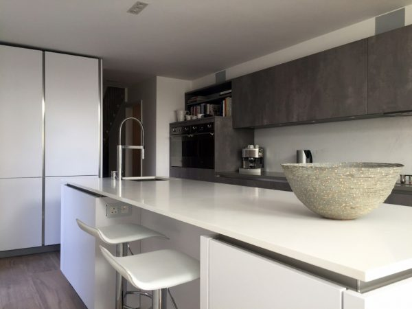 concrete and polar white german kitchen fitted