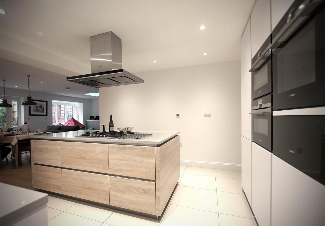 Matt Polar White Handleless with Island – Welwyn | Blax Kitchens Ltd