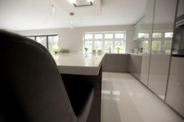 cashmere gloss hacker kitchen with white quartz worktop